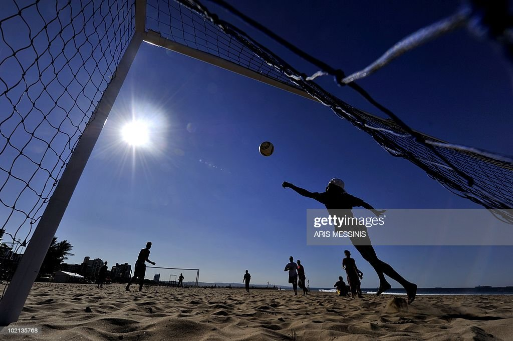 Soccer fans play football at the beach in Durban on 16 June, 2010. The 2010 World Cup hosted by South Africa continues through July 11. AFP PHOTO / Aris Messinis