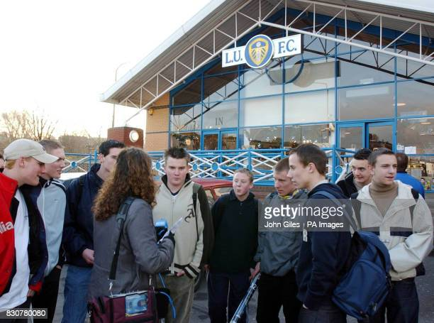 Soccer fans talk to a journalist from a local radio station outside the Leeds United ground following news that the club's player Jonathan Woodgate...