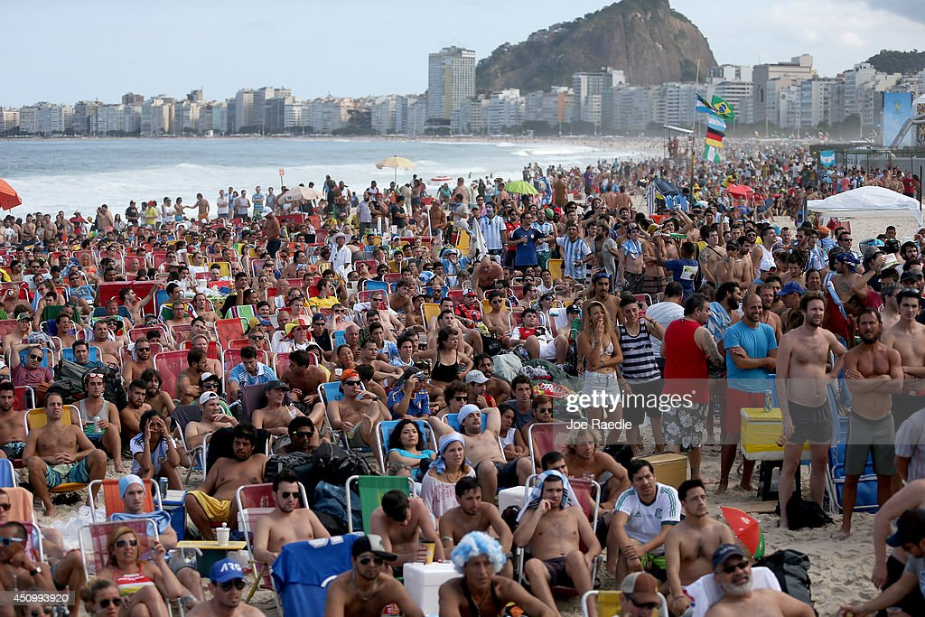 Soccer fans watch Argentina play against Iran on the screen setup at the Word Cup FIFA Fan Fest during on Copacabana beach June 21, 2014 in Rio de Janeiro, Brazil. Argentina won the match 1-0.