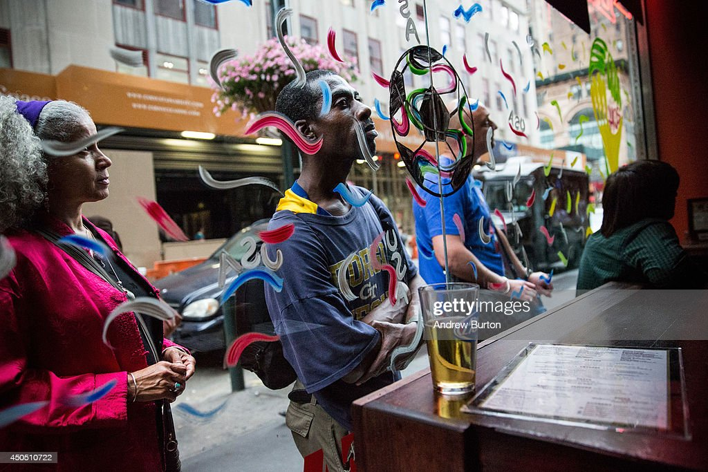 Soccer fans watch the brazil vs croatia world cup game through the