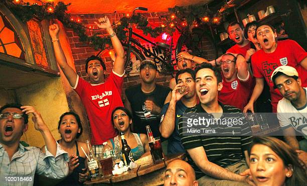 Soccer fans watch the US vs England World Cup match in a pub June 12 2010 in New York City Soccer fans around the world are cheering for their home...