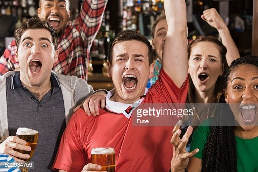 Soccer fans watching game in pub