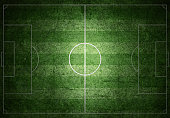 Soccer field with white lines on grass, grunge paper.
