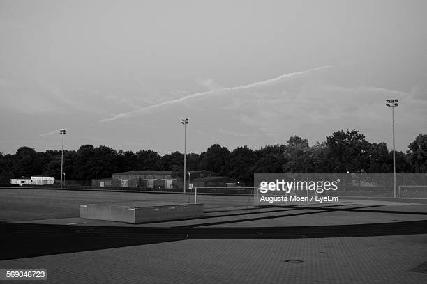 Soccer Field With Floodlights Against Sky