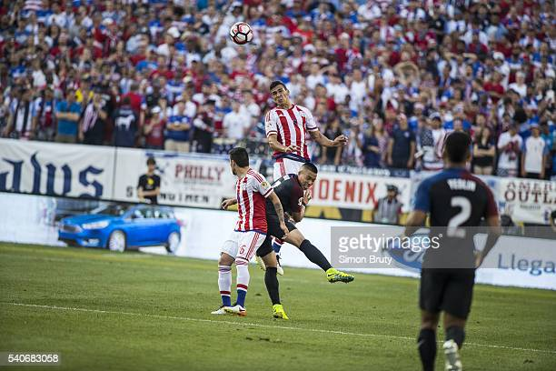 FIFA Copa America Centenario Paraguay Fabian Balbuena in action head ball vs USA Bobby Wood during Group Stage Group A match at Lincoln Financial...