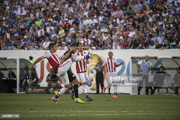 FIFA Copa America Centenario USA Clint Dempsey in action vs Paraguay Fabian Balbuena during Group Stage Group A match at Lincoln Financial Field...