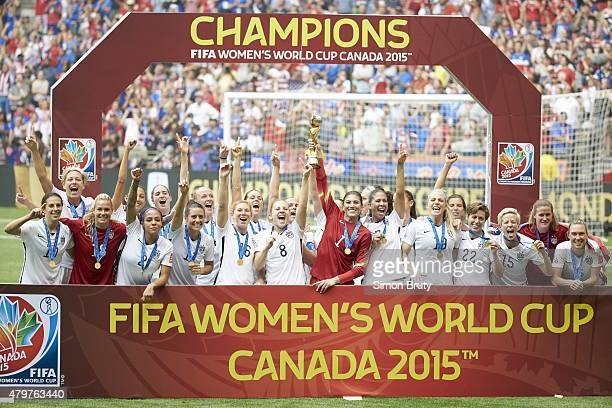 FIFA Women's World Cup Final USA goalie Hope Solo victorious with trophy and teammates after winning game vs Japan at BC Place Vancouver Canada...