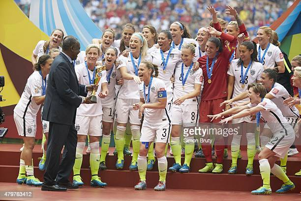 FIFA Women's World Cup Final USA players victorious during trophy presentation with FIFA vicepresident Issa Hayatou after winning game vs Japan at BC...