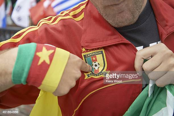 FIFA World Cup Closeup of Cameroon fan posing with team jersey outside of Harlem Tavern in Little Senegal neighborhood before Group Stage Group A...
