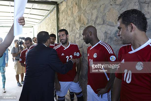 FIFA World Cup Qualification Egypt midfielder Mohamed Aboutrika shakes hands with Egyptian network official in tunnel before CAF Second Round Group G...