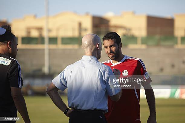 FIFA World Cup Qualification Egypt midfielder Mohamed Aboutrika talks with coach Bob Bradley on the sidelines during their CAF Second Round Group G...