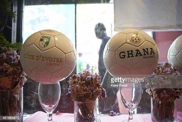 FIFA World Cup View of soccer balls labelled Cote d'Ivoire and Ghana during Group Stage Group A game vs Mexico at Harlem Tavern in Little Senegal...