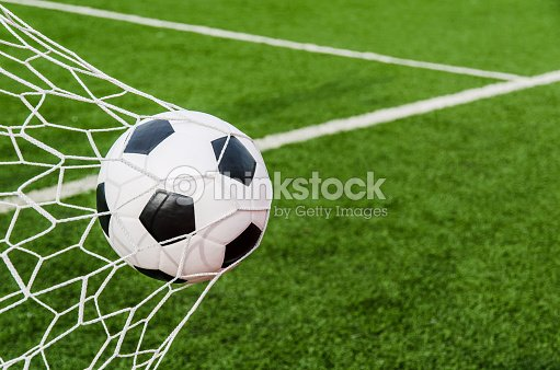 279b908c1 Soccer Football In Goal Net With Green Grass Field Stock Photo ...