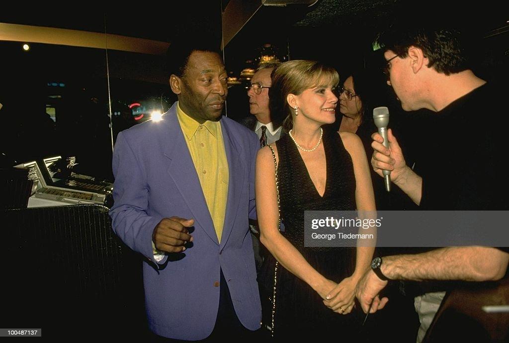 Former player Pele during media interview with wife Assiria Seixas Lemos. New York, NY 5/12/1994