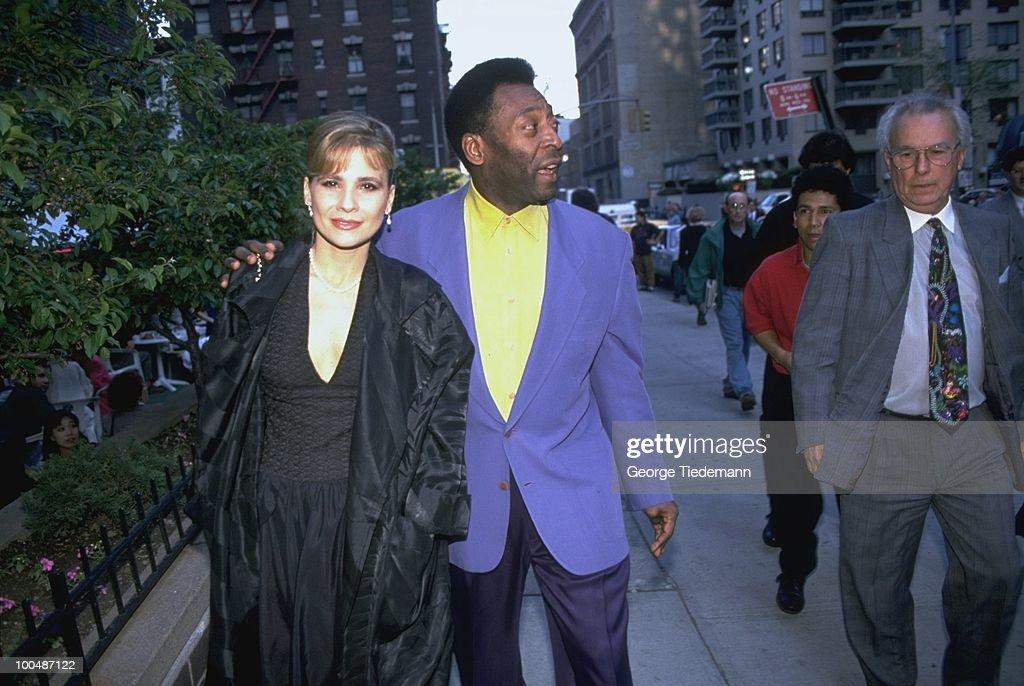 Former player Pele walking down street with wife Assiria Seixas Lemos. New York, NY 5/12/1994