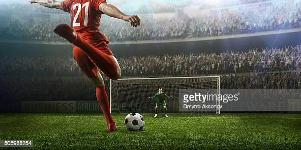 サッカー選手の試合のひとときをお過ごしください。