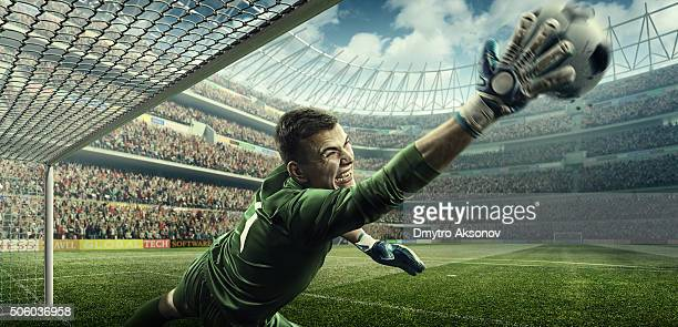 Soccer game moment with goalkeeper