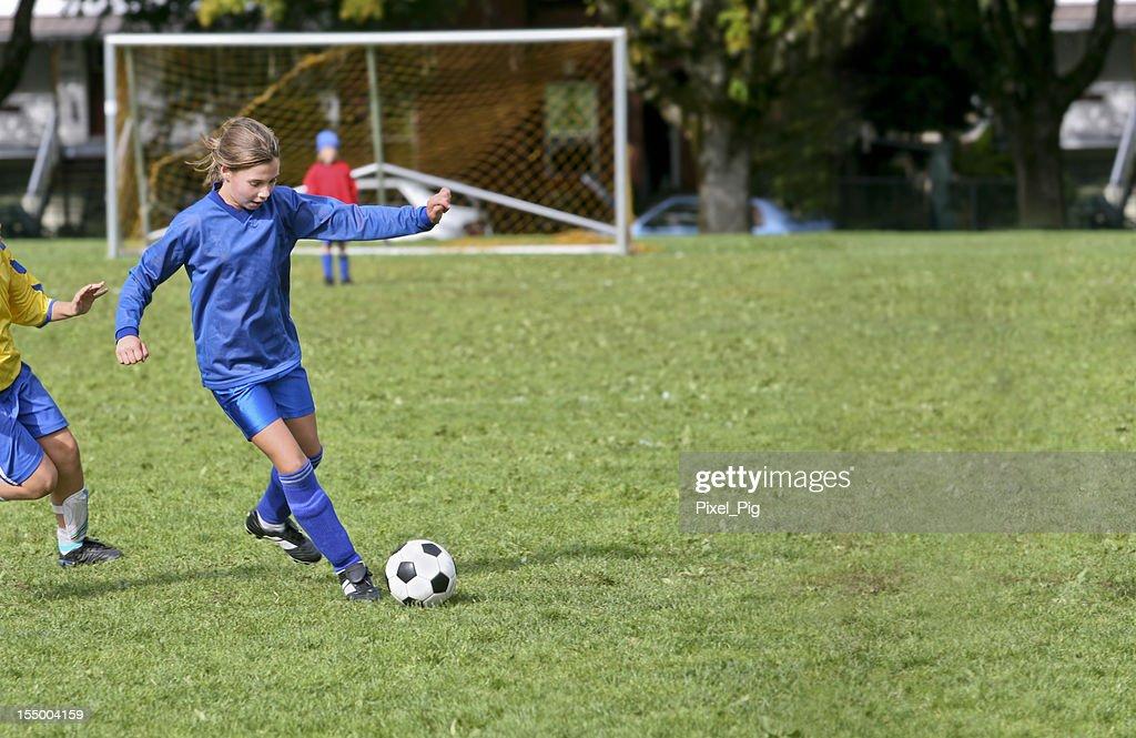 Soccer Girl Keeps her Opponent at Bay : Stock Photo