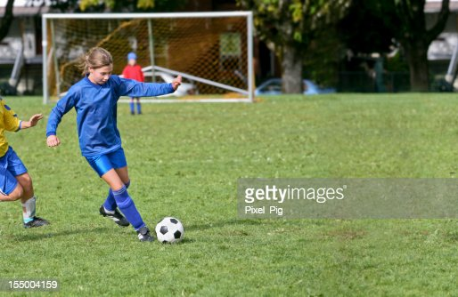 Soccer Girl Keeps her Opponent at Bay : Stock Photo