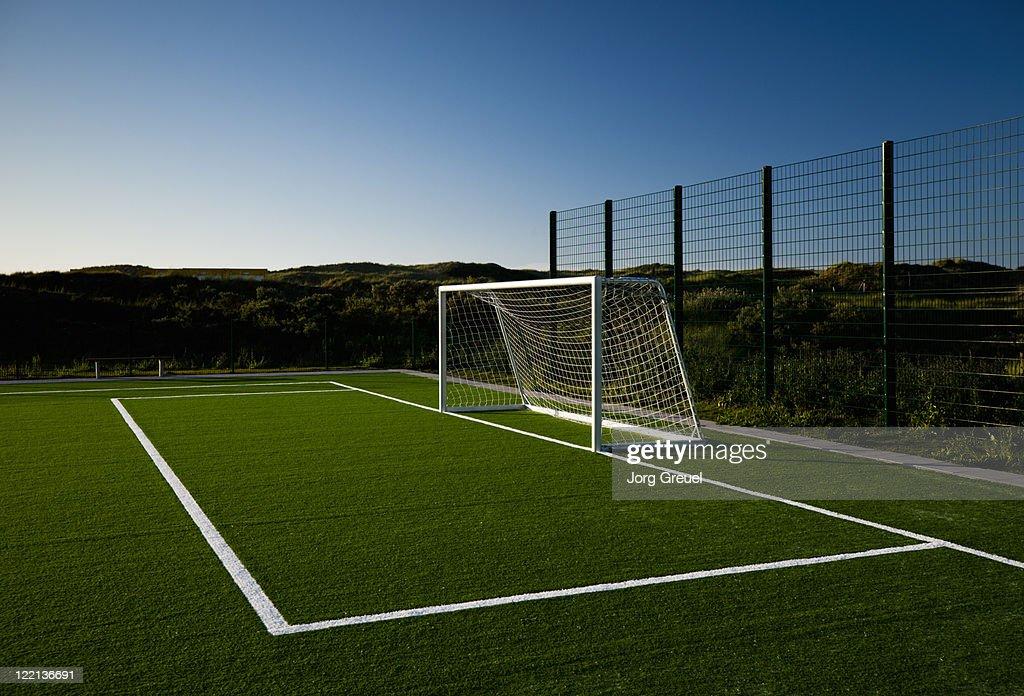 Soccer goal at sunset : Stock Photo