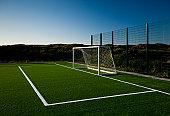 Soccer goal at sunset
