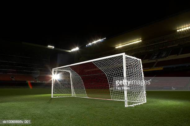 Soccer goal in empty floodlit stadium