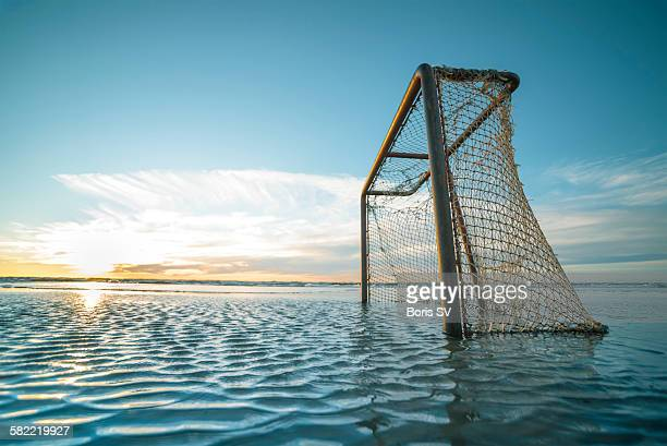 Soccer goal in water all around