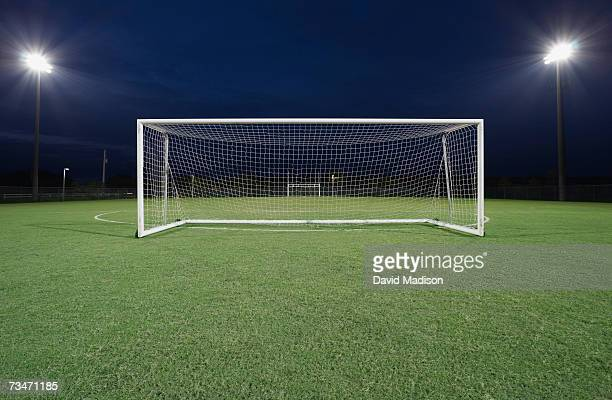 Soccer goal on field at night