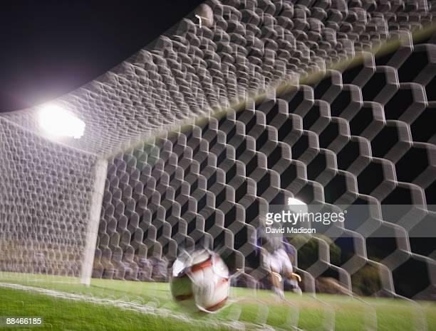 Soccer goalie allows a goal.