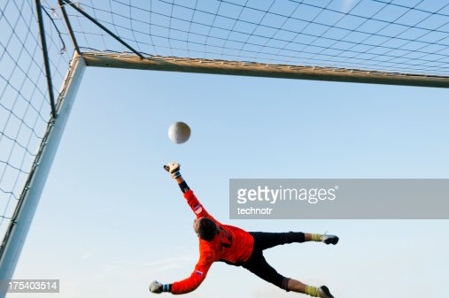 Soccer goalie defending in mid-air