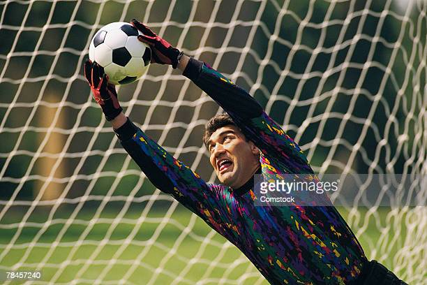 Soccer goalie diving for ball