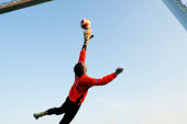 Soccer goalie in mid-air
