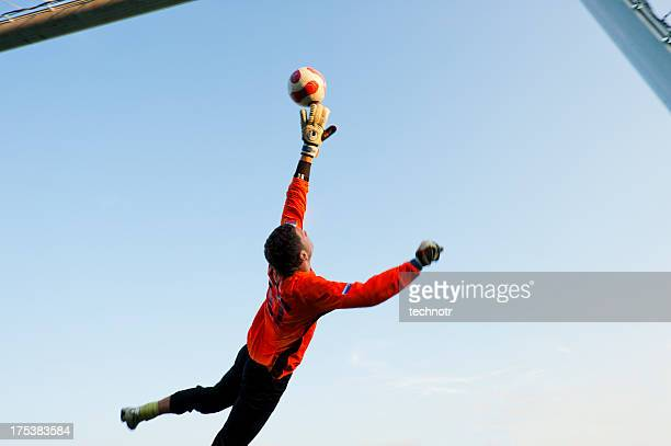 Soccer goalie in mid-air