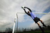 Soccer goalie jumping