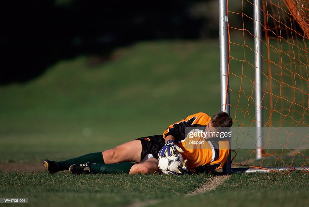 Soccer goalie making a save : Stock Photo