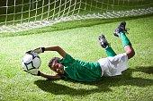 Soccer goalie saving a goal