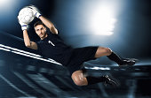 soccer goalkeeper catching ball in mid-air