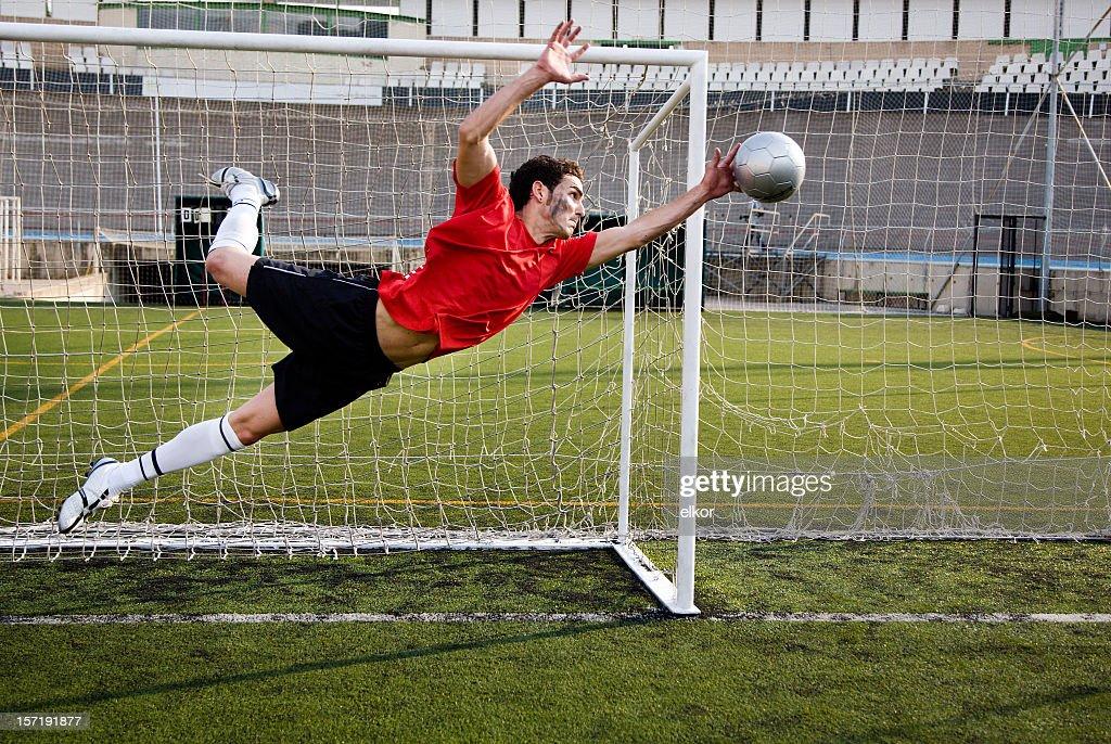 Soccer goalkeeper catching the ball.