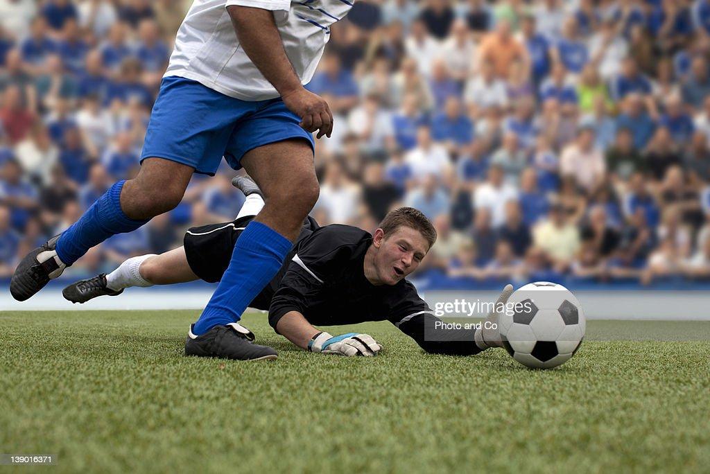 soccer goalkeeper defending goal : Stock Photo