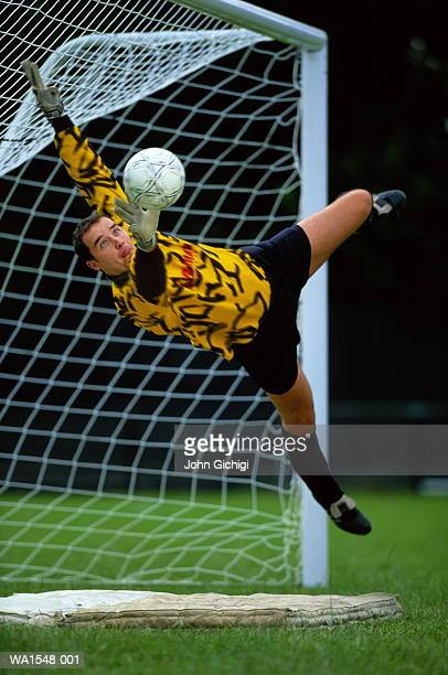 Soccer, goalkeeper leaping for save