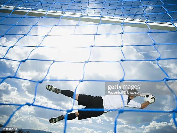 Soccer goalkeeper making diving save