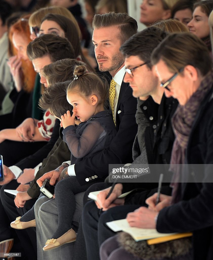 Soccer great <a gi-track='captionPersonalityLinkClicked' href=/galleries/search?phrase=David+Beckham&family=editorial&specificpeople=158480 ng-click='$event.stopPropagation()'>David Beckham</a> with his daughter Harper look on as models present the fashions of Victoria Beckham during the Mercedes-Benz Fashion Week Fall/Winter 2014 shows February 9, 2014 in New York City. AFP PHOTO / Don EMMERT