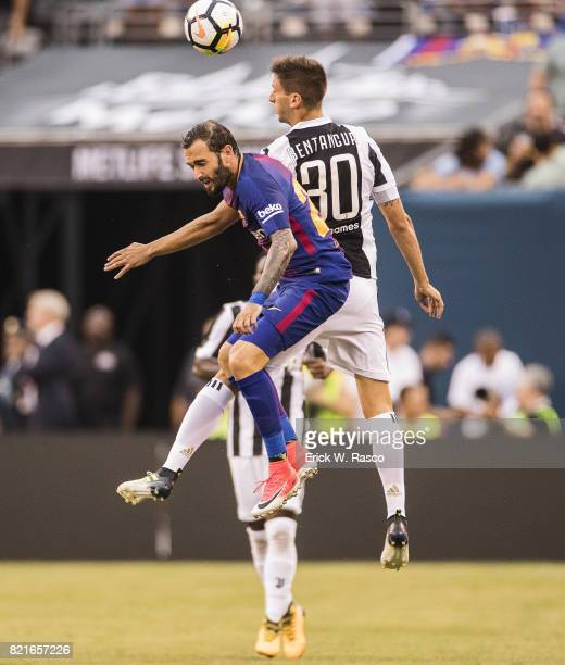 International Champions Cup FC Barcelona Aleix Vidal in action vs Juventus FC Rodrigo Bentancur at MetLife Stadium East Rutherford NJ CREDIT Erick W...