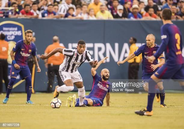 International Champions Cup Juventus FC Mario Lemina in action vs FC Barcelona Mascherano at MetLife Stadium East Rutherford NJ CREDIT Erick W Rasco