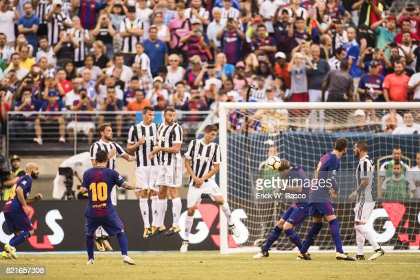 International Champions Cup Rear view of FC Barcelona Lionel Messi in action vs Juventus FC Claudio Marchisio Mario Mandukic Andrea Barzagli and...