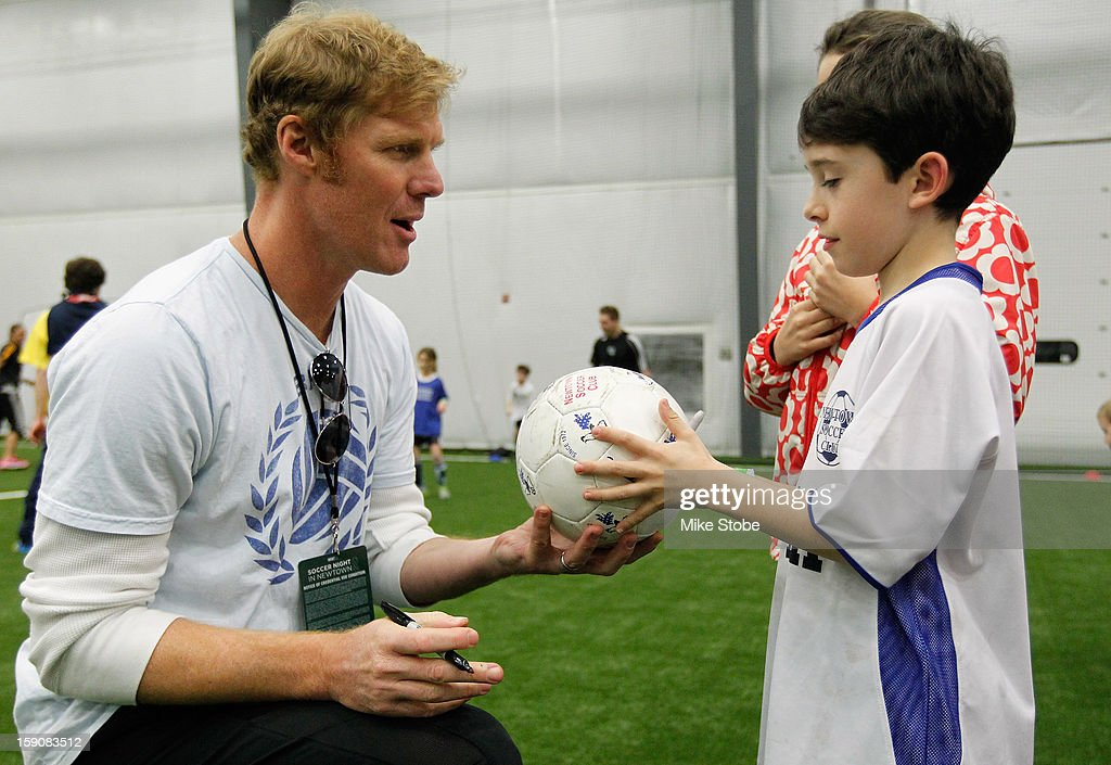 US Soccer Legend <a gi-track='captionPersonalityLinkClicked' href=/galleries/search?phrase=Alexi+Lalas&family=editorial&specificpeople=577413 ng-click='$event.stopPropagation()'>Alexi Lalas</a> signs autographs during Soccer Night In Newtown at Newtown Youth Academy Sports & Fitness Center on January 7, 2013 in Newtown, Connecticut.