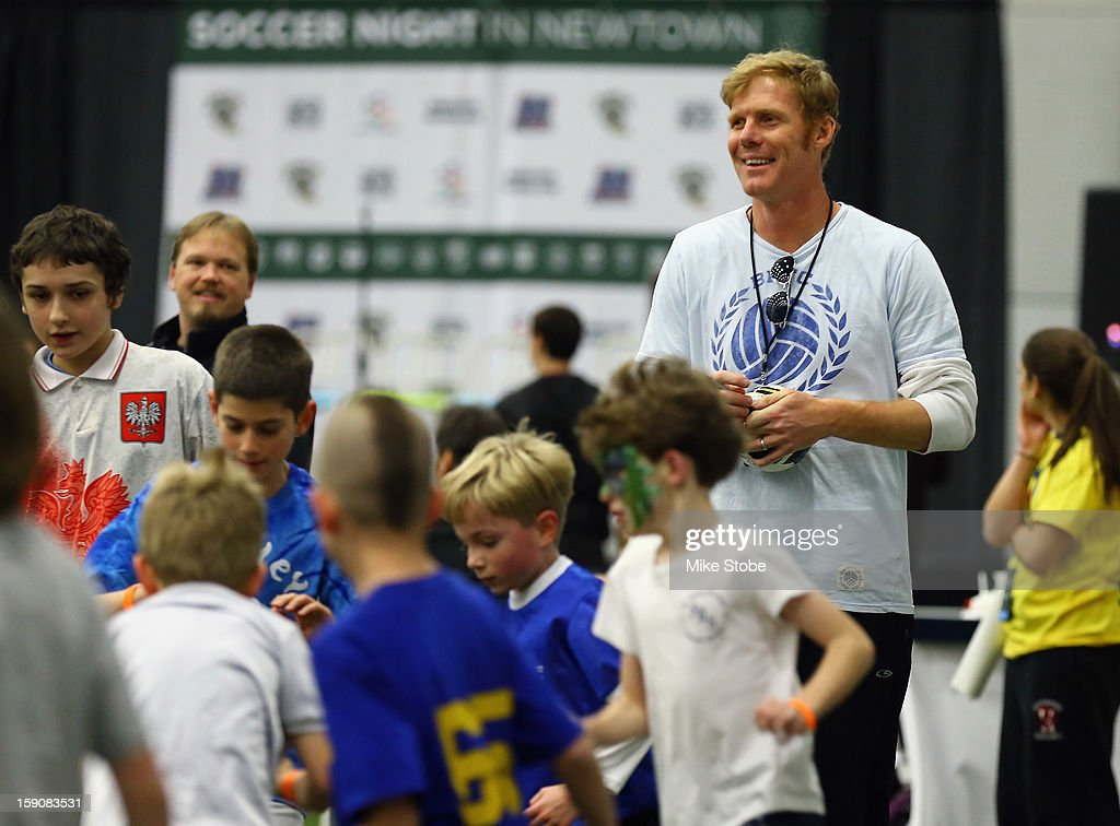 US Soccer Legend <a gi-track='captionPersonalityLinkClicked' href=/galleries/search?phrase=Alexi+Lalas&family=editorial&specificpeople=577413 ng-click='$event.stopPropagation()'>Alexi Lalas</a> signs looks on during Soccer Night In Newtown at Newtown Youth Academy Sports & Fitness Center on January 7, 2013 in Newtown, Connecticut.
