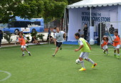 Soccer legend Cobi Jones shows off his moves on the field with youth soccer players at the grand opening celebration of the new Windows Store Only at...