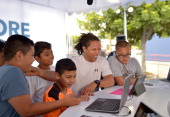 Soccer legend Cobi Jones shows off the latest fitness apps on Windows 8 to young soccer fans at the grand opening celebration of the new Windows...