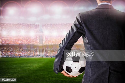 soccer manager against supporters in the stadium : Stock Photo